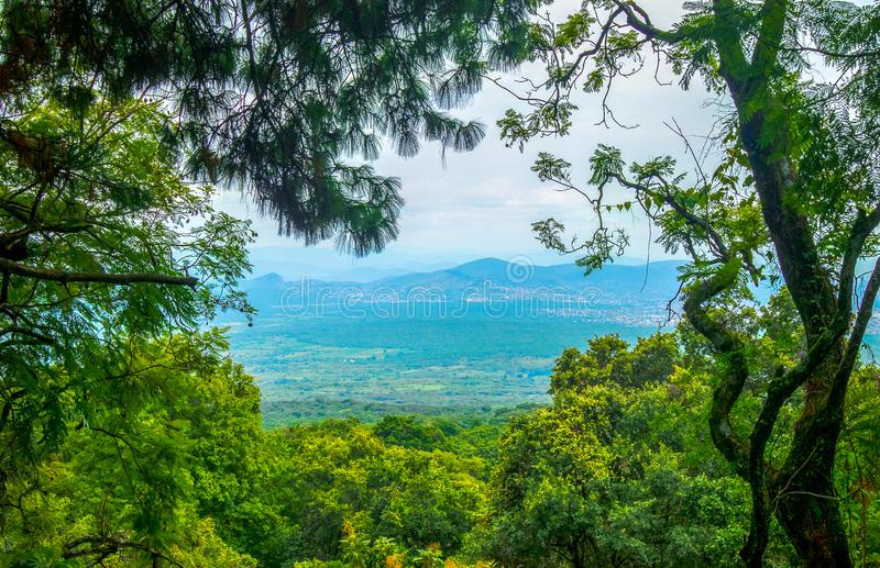 Scenic landscape mexico blue sky green trees mountain artistic. Beautiful scenic traditional landscape mexico blue sky green trees mountain artistic evening stock photos