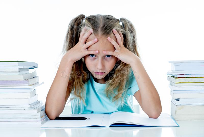 Beautiful school girl having too many homework and it is driving her crazy in motivation low performance children. Beautiful school girl trying to study having royalty free stock photos