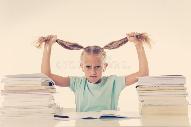 Beautiful school girl trying to study and is driving her crazy in motivation low performance children. Beautiful school girl trying to study having too many stock images