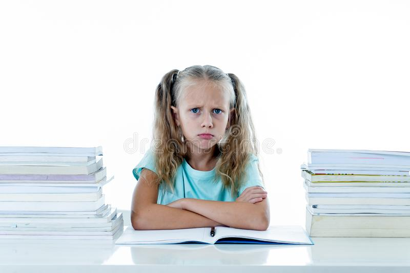 Frustrated little schoolgirl feeling a failure unable to concentrate in reading and writing difficulties learning problem. Attentional disorders special needs stock photo