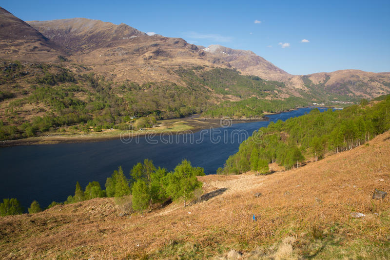 Beautiful Scottish Loch Leven Scotland in summer with mountains sunshine and blue sky. Beautiful Scottish Loch Leven Scotland UK in summer with mountains royalty free stock image