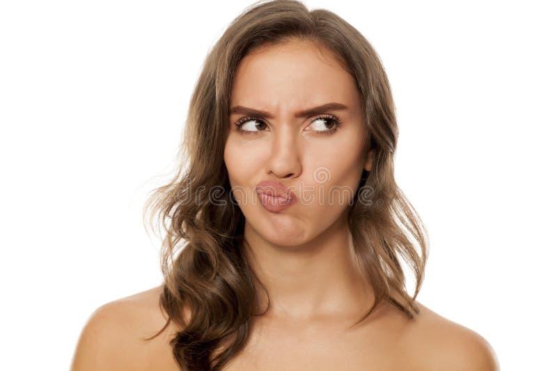 Beautiful scowling woman stock photo