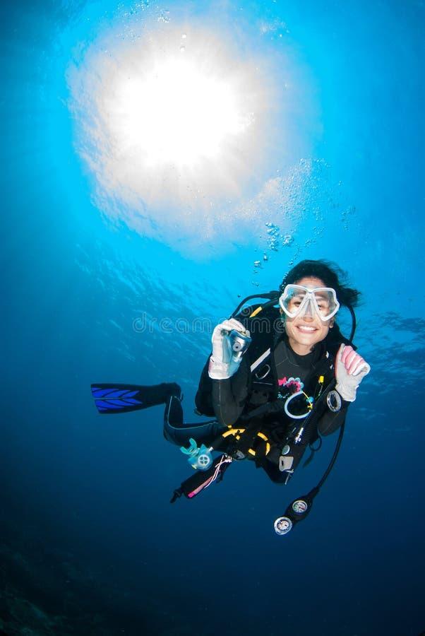 Beautiful Scuba diver smile cheerfully . stock photos