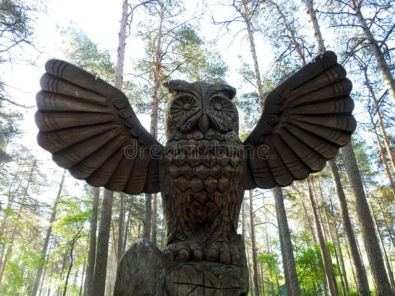 Owl  bird done from wood in park, Lithuania royalty free stock photo