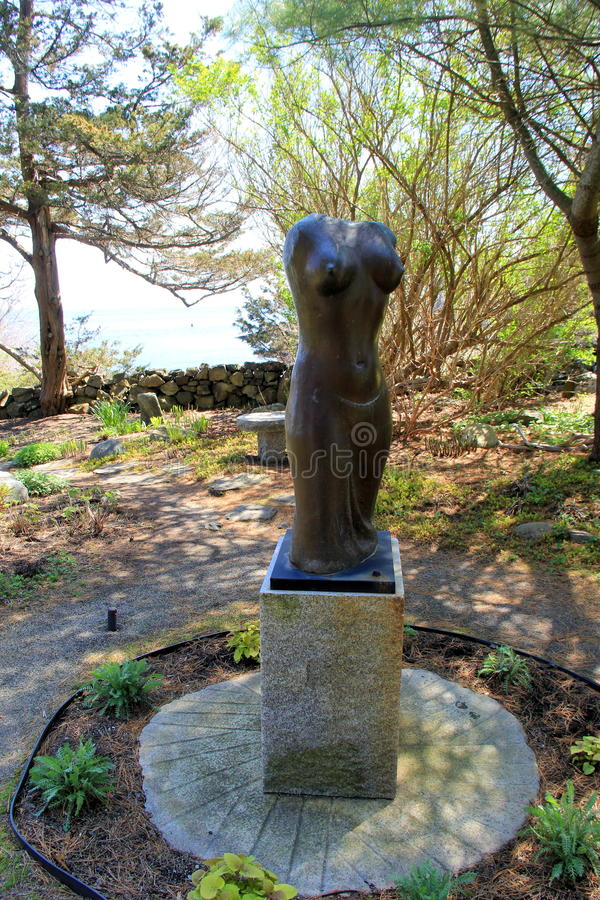 Beautiful sculpture of semi-nude woman's body,set in peaceful garden,Ogunquit Museum of American Art,Maine,2016 stock photography