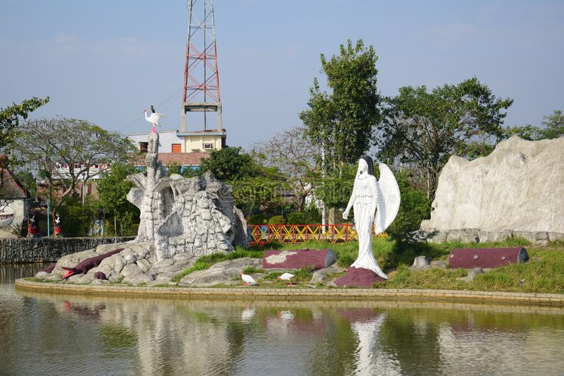 Beautiful  sculptures  in the middle  of the pond in Rajshahi  zia shihu park. Beautiful sculptures middle pond rajshahi zia shihu park design mermaid egret stock photo