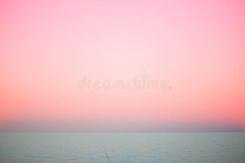 Beautiful sea, pink sunset, nature, summer. The concept of fashion colors royalty free stock images