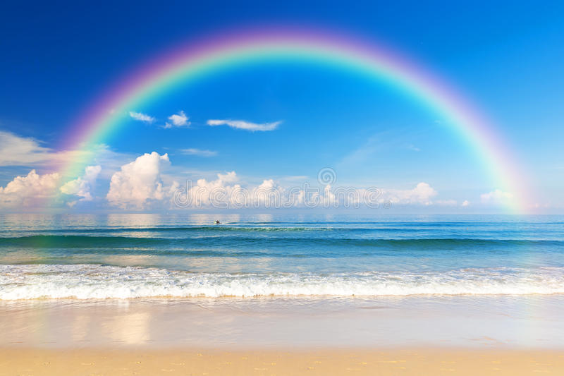 Beautiful sea with a rainbow in the sky stock photography