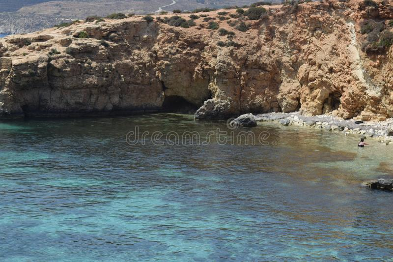 A beautiful sea scene of the Blue Lagoon Malta. people enjoying the sunshine and sea . A beautiful sea scene of the Mediterranean sea at the blue lagoon in royalty free stock photo