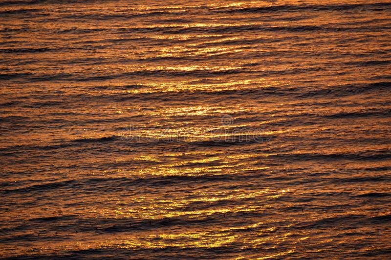 Sun Reflection in a Calm Sea Water royalty free stock image