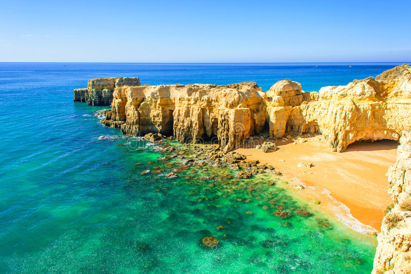 Beautiful sea view with secret sandy beach near Albufeira in Algarve, Portugal. Beautiful sea view with secret sandy beach among rocks and cliffs near Albufeira stock images