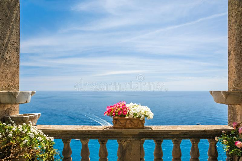 Beautiful sea view in the town of Positano from antique terrace with flowers, Amalfi coast, Italy stock photo