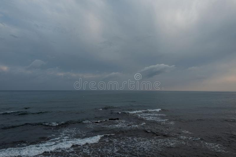Beautiful sea with waves and sky with clouds in the evening for background. Ocean horizon. Nice seascape. Beautiful sea with waves and sky with clouds in the stock image