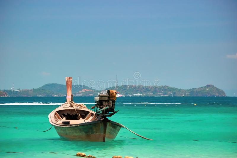 Beautiful seascape. Long Tail wooden boat in turquoise clear sea water. Tranquil waters, vacation wallpaper. royalty free stock photo