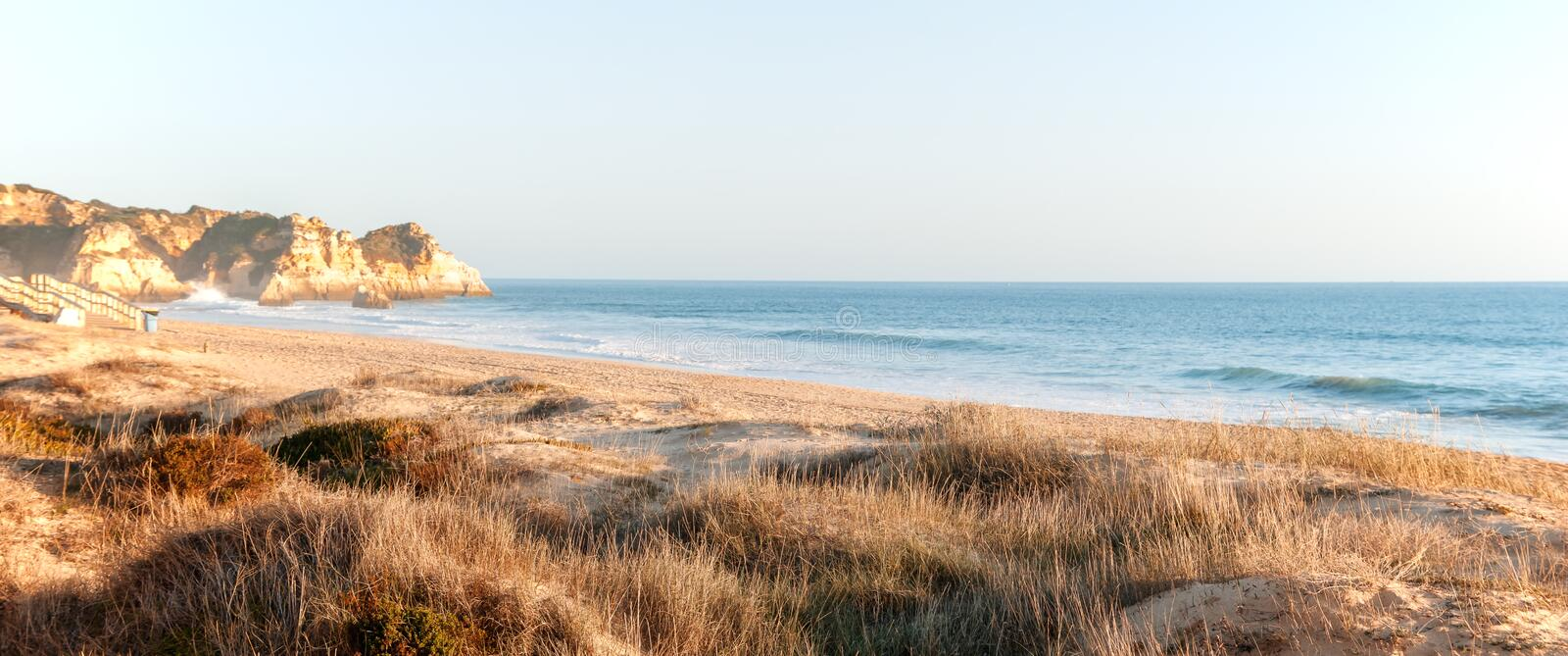 Beautiful seascape in pastel tones, sand dunes and seashore, pa stock photos