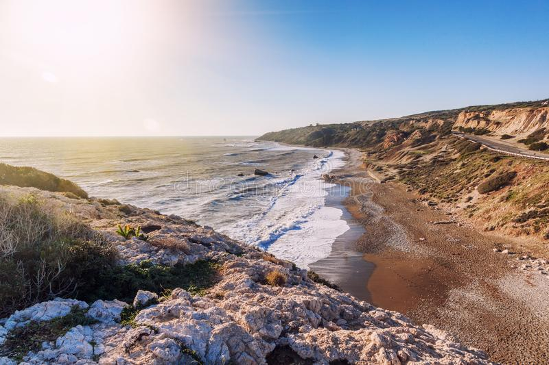 beautiful seascape, pebble beach, rocks, the famous beach of Aphrodite at sunset, the island of Cyprus, a popular destination for royalty free stock photos