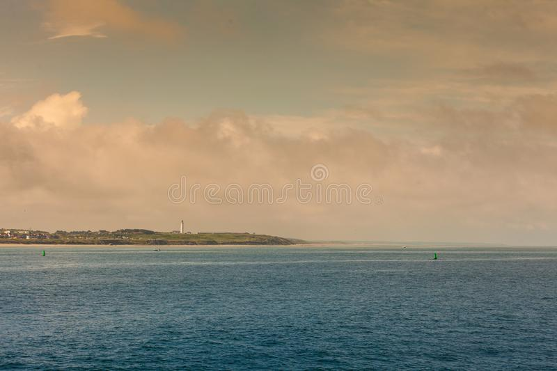 Coastline with lighthouse Hirtshals Denmark. Beautiful seascape sea horizon and coastline with lighthouse Hirtshals, Denmark, Europe royalty free stock photography