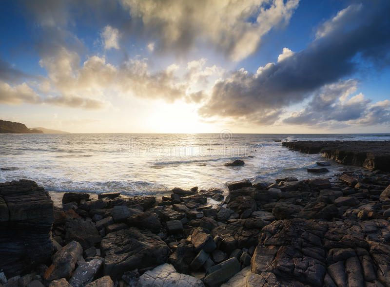 Beautiful seascape at sunset with dramatic clouds landscape image stock images