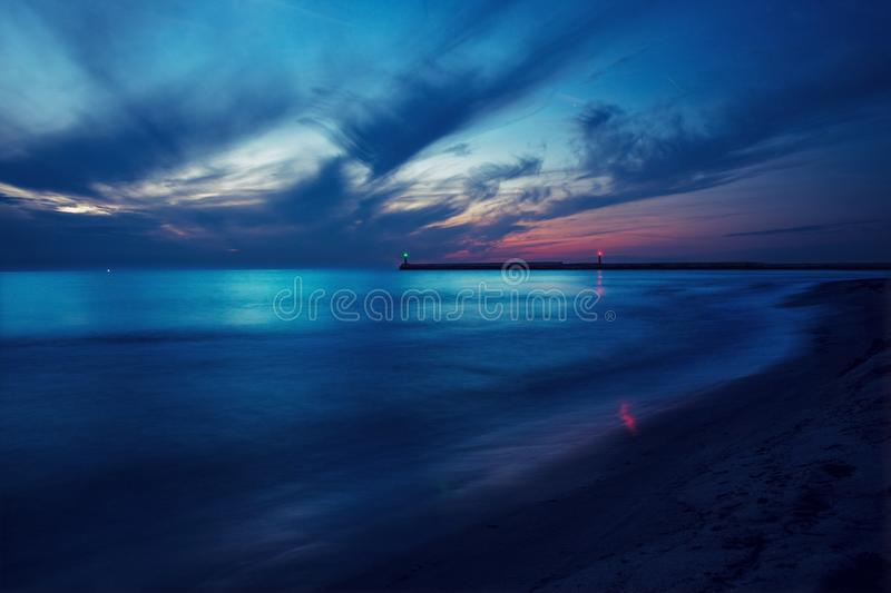 Beautiful seascape with two lighthouses at blue hour. Long exposure night shot royalty free stock image