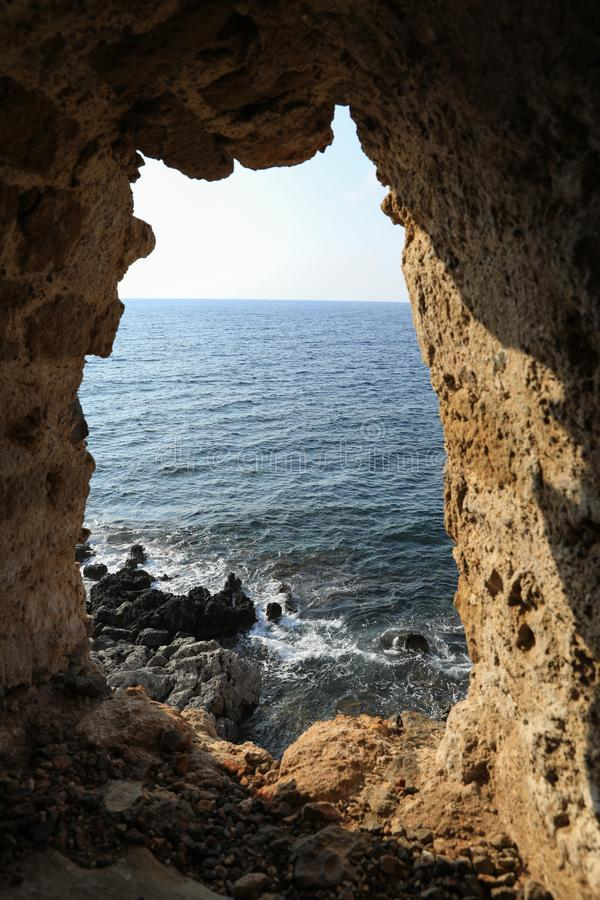 Beautiful seascape view through loophole of Monemvasia medieval castle overlooking the Aegean sea. Monemvasia, Peloponnese, Greece royalty free stock photography