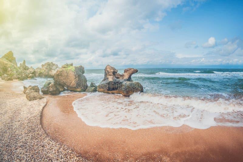 Beautiful seascape. Wild rocky sandy seashell beach. A small cozy bay. royalty free stock photo