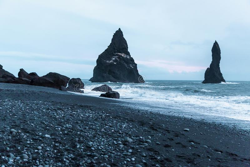 Beautiful seashore with rocks and cliffs, vik dyrholaey, reynisfjara. Beach, iceland royalty free stock photo