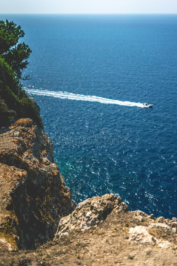 Beautiful seaside landscape from high altitude. Rocky cliff. royalty free stock image