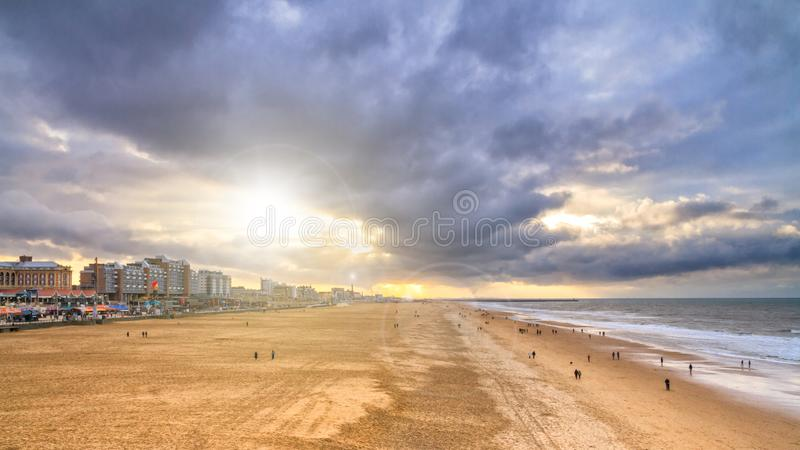 Beautiful seaside landscape - view of the beach near the embankment of The Hague royalty free stock photography