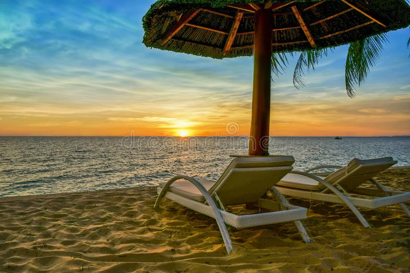 The beautiful seaside of Phu Quoc island in Vietnam. Sunset on the beach at Vietnam`s Phu Quoc Island. Relaxation area watching the sea at Famiana resort stock photography