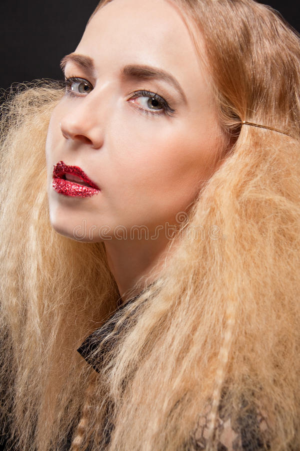 Beautiful seductive woman with parted lips. Beautiful seductive blond woman with red parted lips and a sultry expression looking sideways at the camera with an stock images