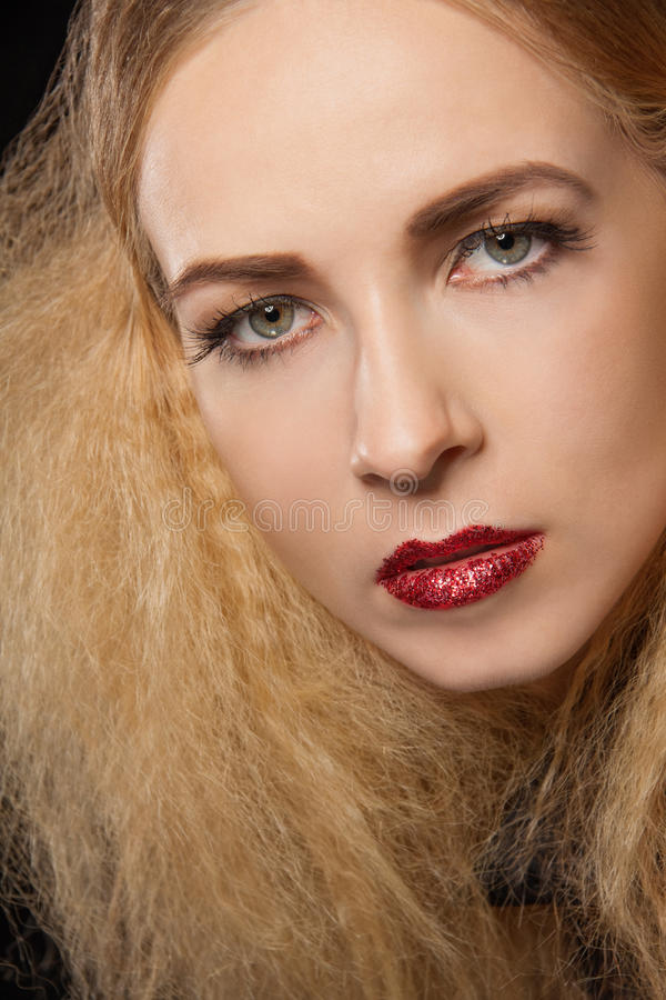 Beautiful seductive woman with parted lips. Beautiful seductive blond woman with red parted lips and a sultry expression looking sideways at the camera with an stock photos