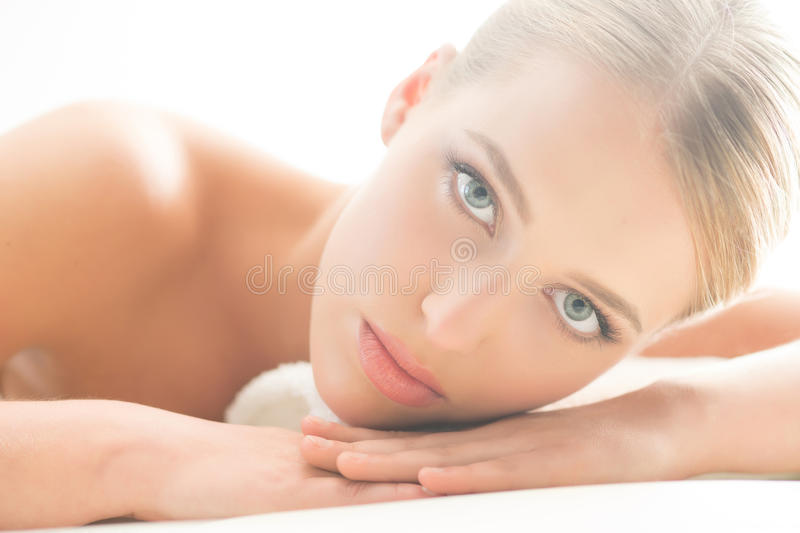 Beautiful and seductive young woman with pure skin on isolated background stock photo
