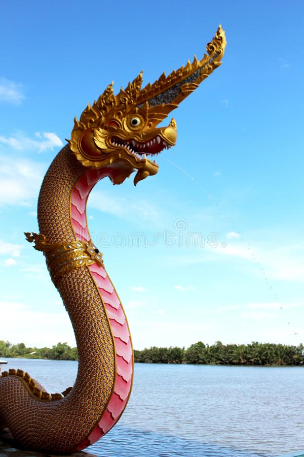 Beautiful Pink and Gold colors of Praya Nark or Naga in Thai temple with colorful sky and sun flare effect on sunrise time. Beautiful Selective Focus Pink and stock photo