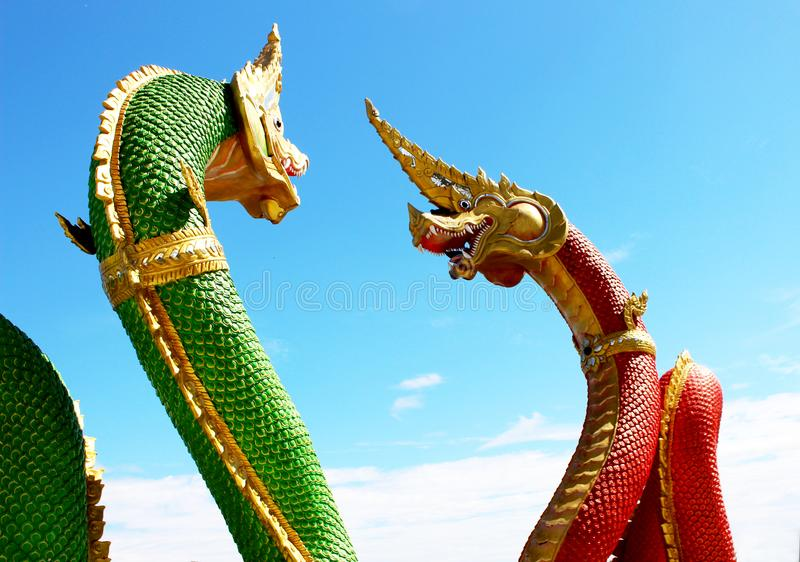 Beautiful Green and Red colors of Praya Nark or Naga in Thai temple with colorful sky and sun flare effect on sunrise time. Beautiful Selective Focus Red and stock photography