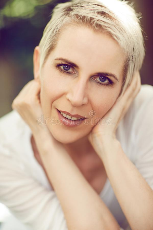 Beautiful and self confident middle aged woman portrait close up stock photos