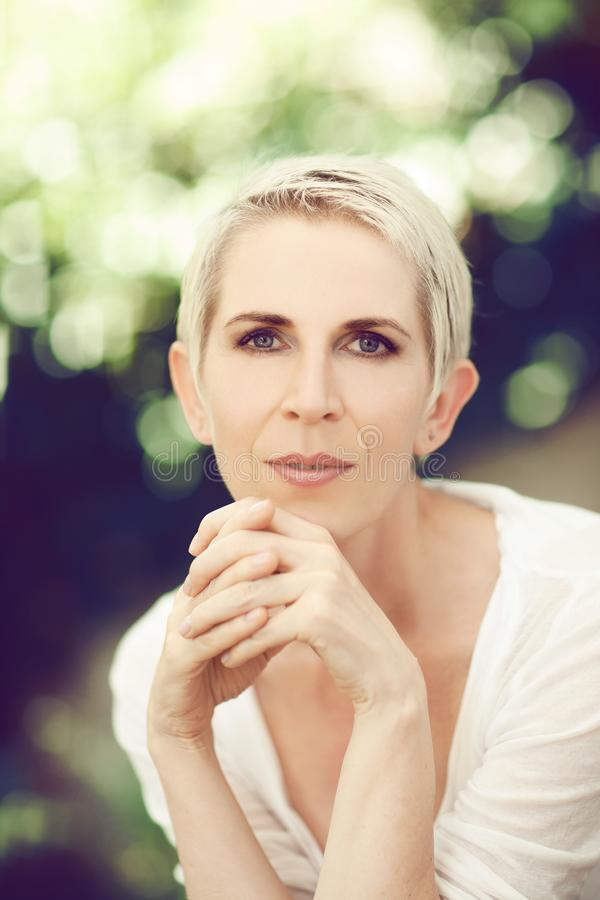 Beautiful and self confident middle aged woman portrait close up royalty free stock photography