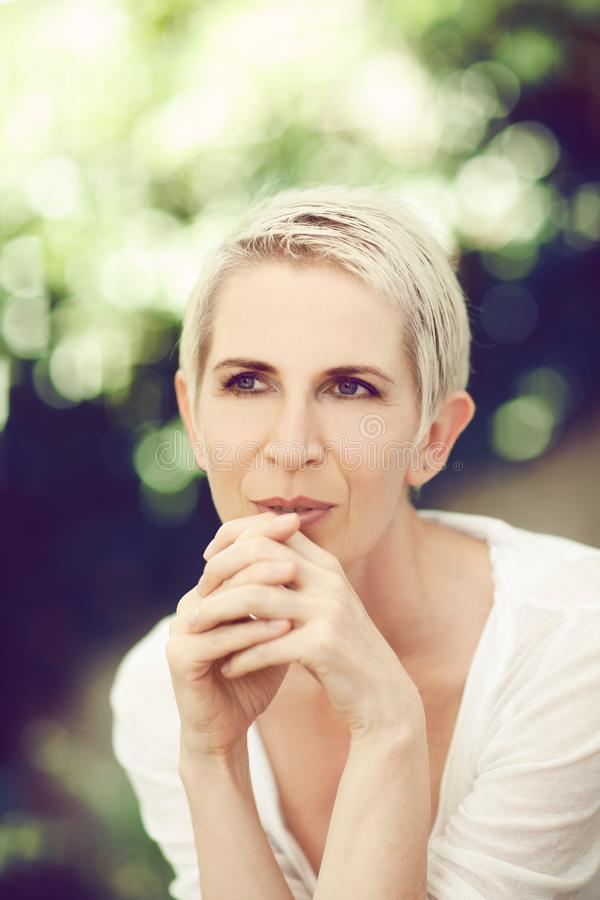 Beautiful and self confident middle aged woman portrait close up stock image