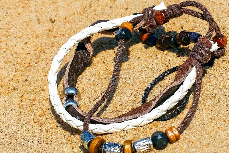 Beautiful semi-precious stone beads. Leather braided bands in the bracelet. Brown and white. stock photo