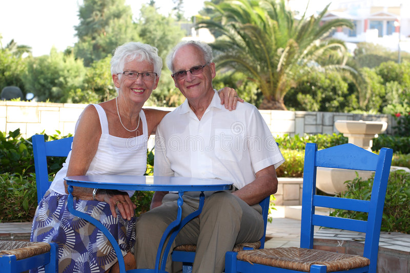 Beautiful senior couple. Relaxing outdoors on a sunny day royalty free stock image