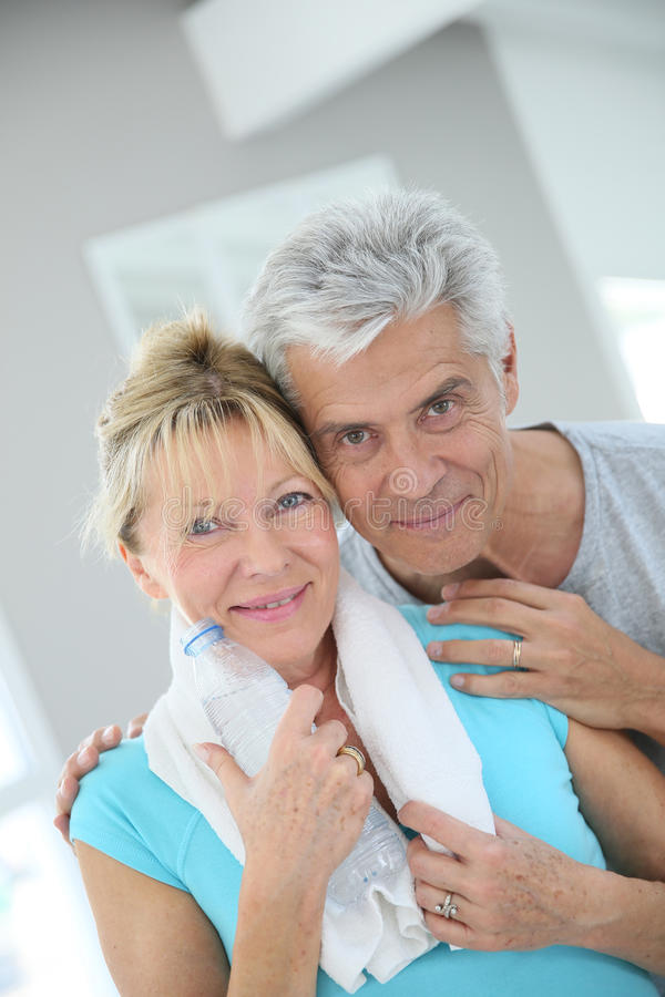 Beautiful senior couple in fitness outfit royalty free stock photos