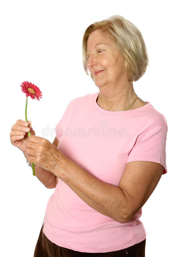 Beautiful senior with flower royalty free stock image