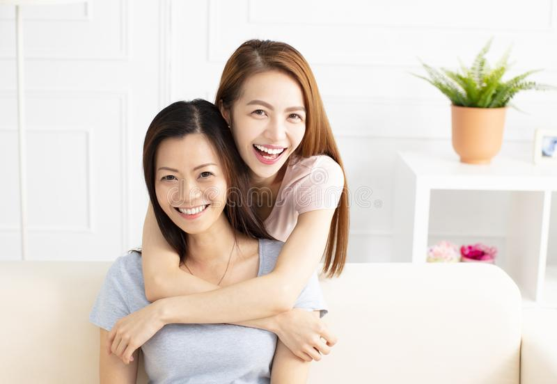 senior mom and her adult daughter stock photos