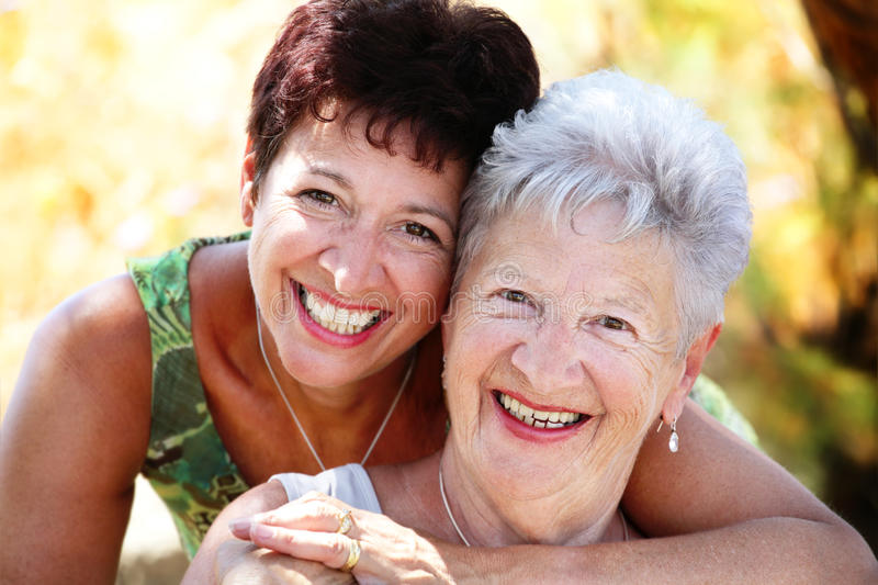 Beautiful senior mother and daughter smiling royalty free stock photography