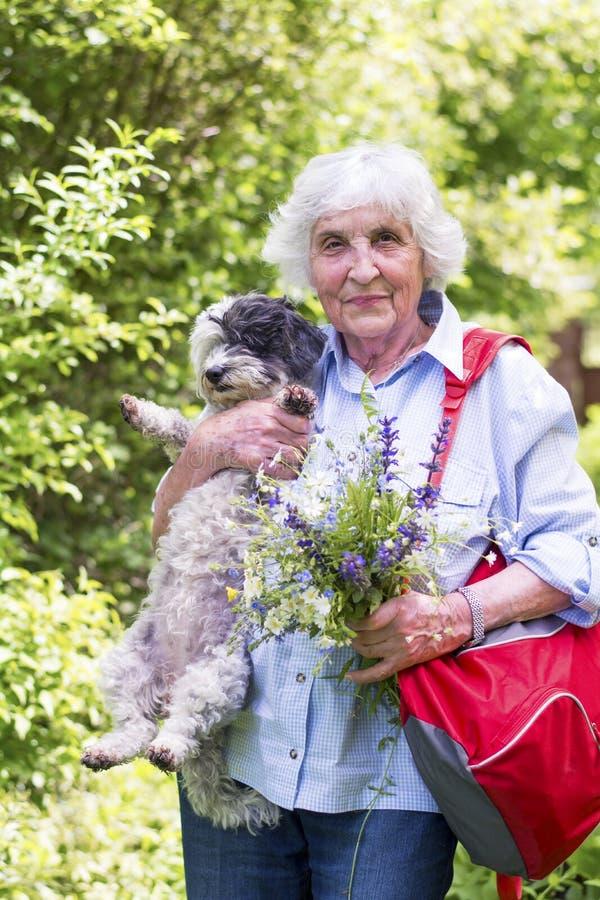 Free Beautiful Senior Woman Hugging Her Dog Stock Photography - 50559642