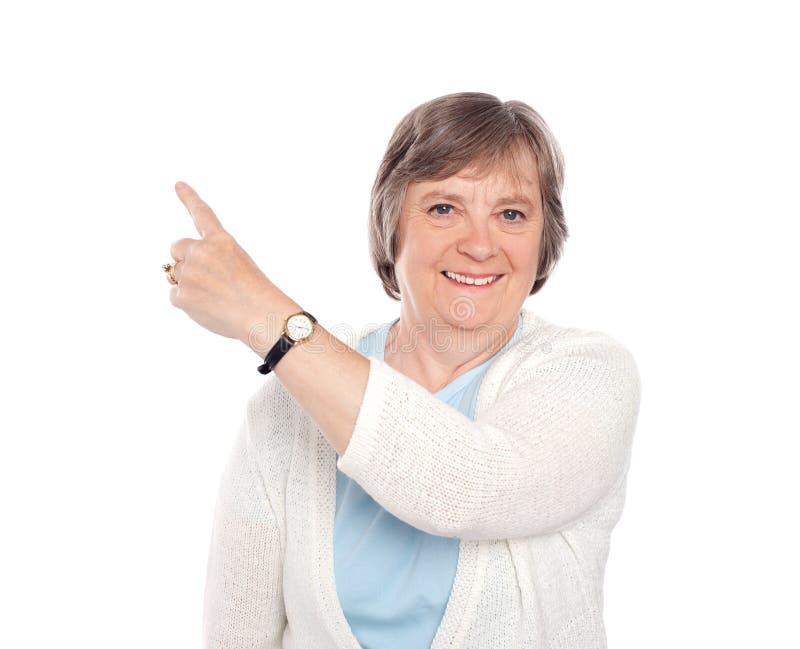 Download Beautiful Senior Woman Indicating Copy Space Stock Photo - Image: 25621816