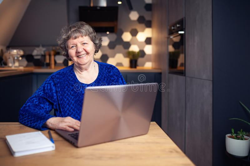 Beautiful senior woman in modern home stock photography