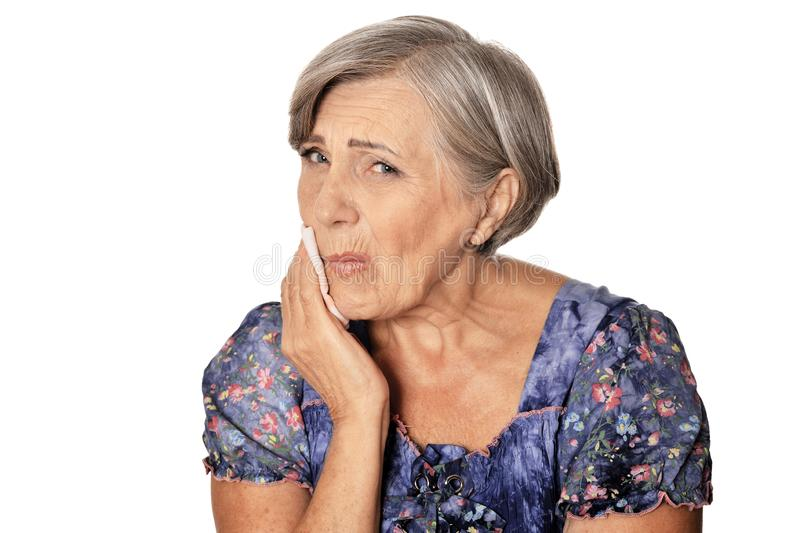 Close up portrait of beautiful senior woman with toothache isolated on white background stock image