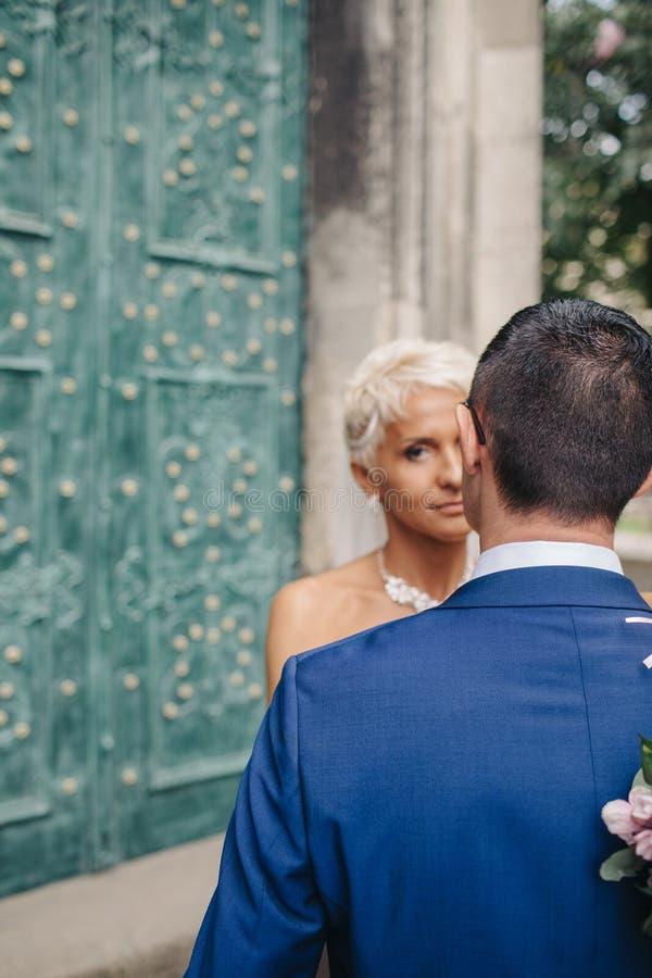 Beautiful sensual bride hugging handsome groom closeup stock photos