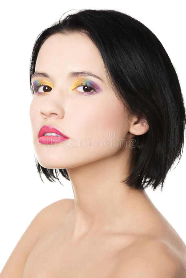Beautiful brunette with rainbow make up stock images