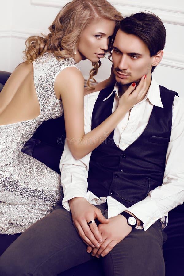 Beautiful sensual couple in elegant clothes posing in studio stock image